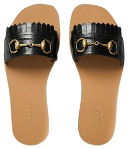 3880bd5a3601 Gucci Rockstud Studded Flat Slide black Sandals · Gucci. Black Horsebit  Varadero Gold Fringed ...