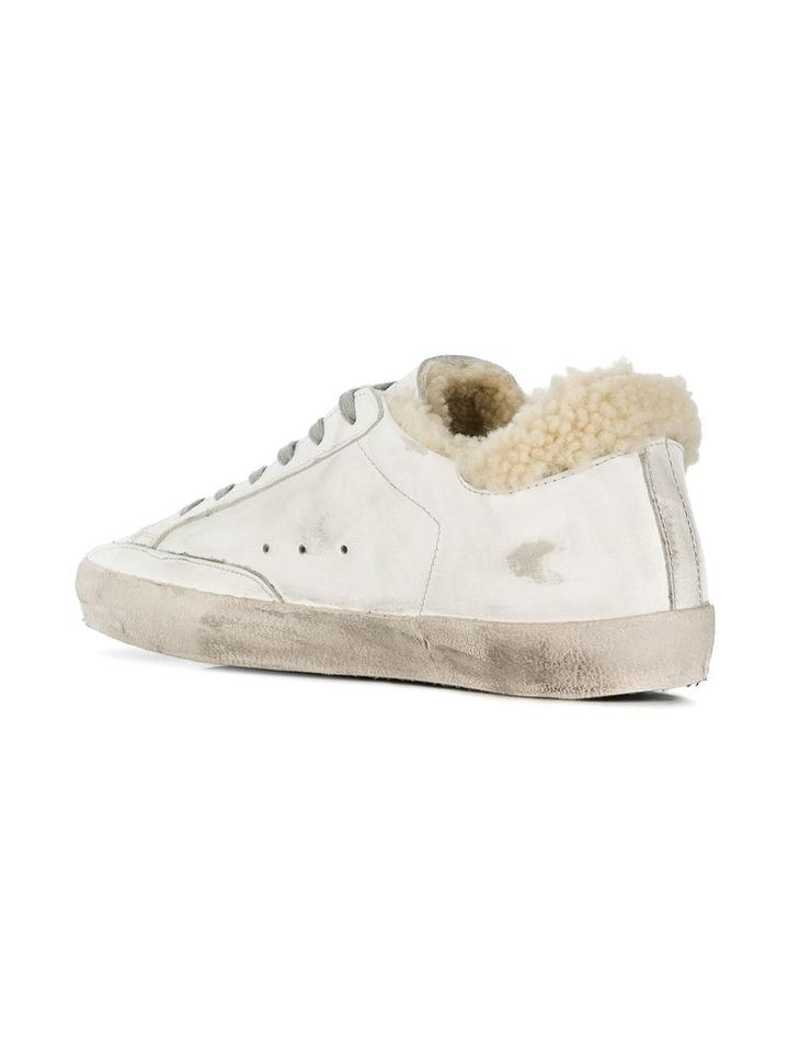 757b022f4a0ce Golden Goose Deluxe Brand White Or Ivory Shearling Superstar Sneakers  Sneakers