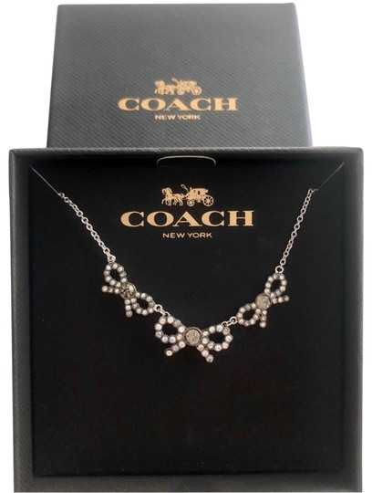 Preload https://img-static.tradesy.com/item/24945292/coach-silver-3-bow-necklace-0-1-540-540.jpg