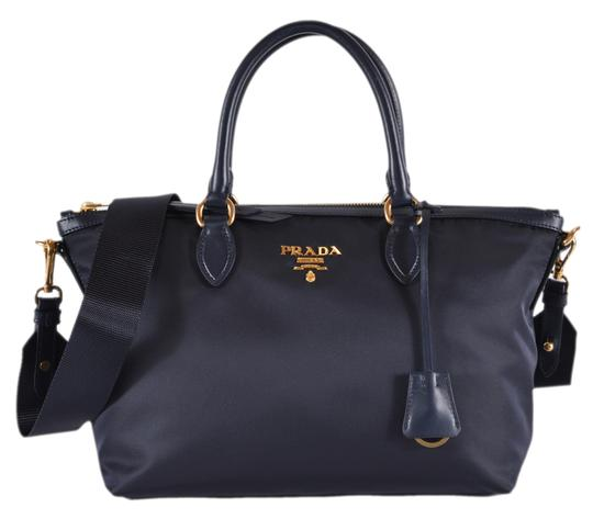 Preload https://img-static.tradesy.com/item/24946973/prada-new-borsa-a-mano-2-way-zip-purse-handbag-blue-nylon-and-leather-cross-body-bag-0-0-540-540.jpg