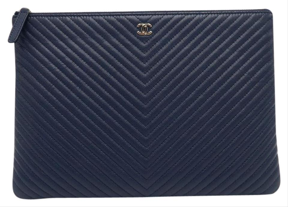 1614ae84704 Chanel Clutch Chevron Quilted Medium O Case Navy Caviar Leather ...