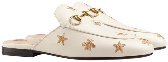 Preload https://img-static.tradesy.com/item/24949876/gucci-white-new-princetown-bee-loafers-mulesslides-size-us-95-regular-m-b-0-1-540-540.jpg