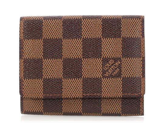 Preload https://img-static.tradesy.com/item/24952759/louis-vuitton-brown-damier-ebene-coated-canvas-card-case-0-0-540-540.jpg