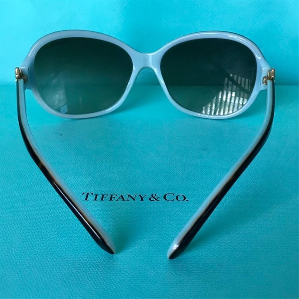 55084ff69010 Tiffany   Co. Tortoise Brown Blue Frames with Gold Daisy Flower W ...