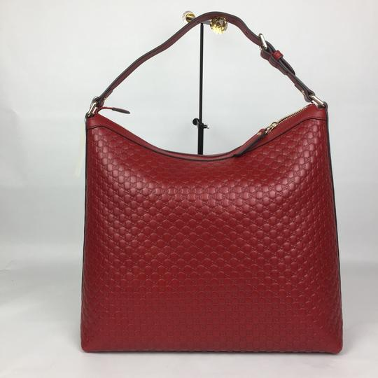 Preload https://item1.tradesy.com/images/gucci-gg-guccissima-leather-red-hobo-bag-24960815-0-4.jpg?width=440&height=440