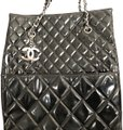 Chanel Tote in Black with silver chain straps and silver CC charm.
