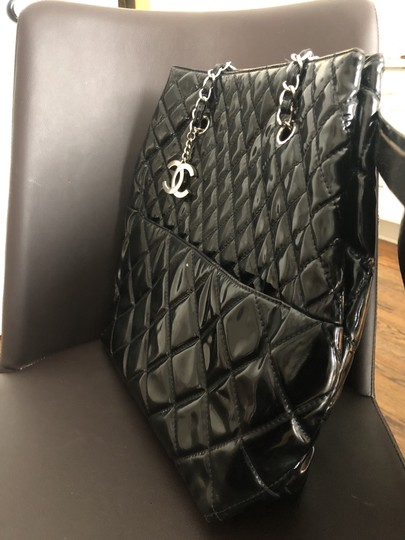 Chanel Tote in Black with silver chain straps and silver CC charm. Image 1