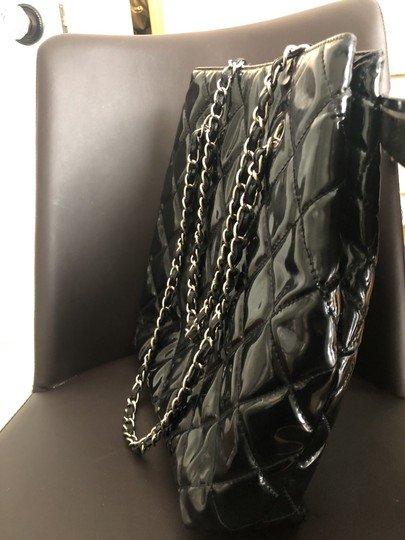 Chanel Tote in Black with silver chain straps and silver CC charm. Image 2