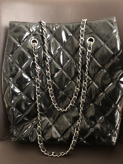 Chanel Tote in Black with silver chain straps and silver CC charm. Image 3