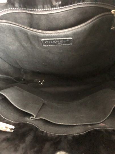 Chanel Tote in Black with silver chain straps and silver CC charm. Image 4