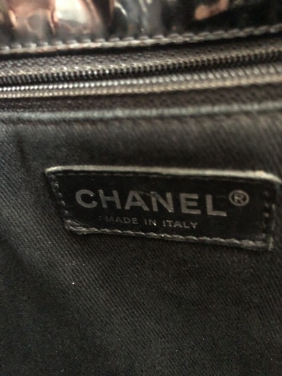 Chanel Tote in Black with silver chain straps and silver CC charm. Image 5