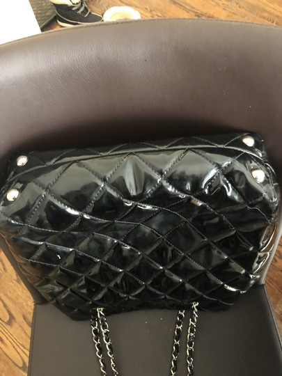 Chanel Tote in Black with silver chain straps and silver CC charm. Image 6