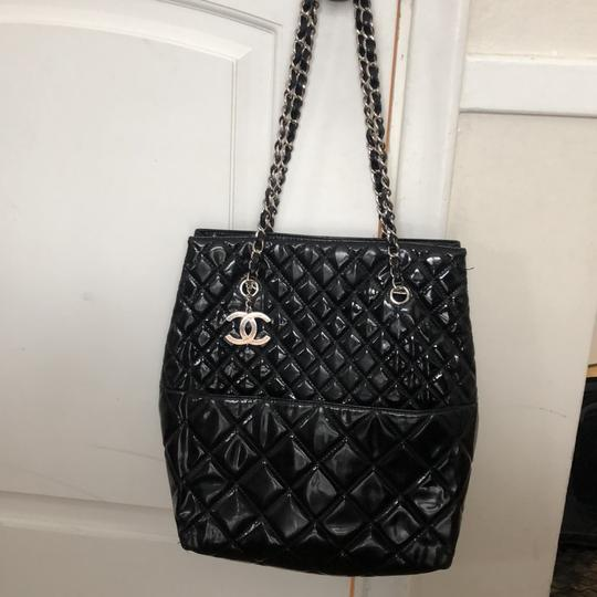 Chanel Tote in Black with silver chain straps and silver CC charm. Image 7