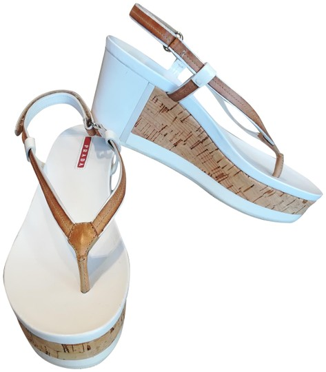 Preload https://img-static.tradesy.com/item/24974828/prada-white-tan-cork-and-leather-sandals-size-eu-375-approx-us-75-regular-m-b-0-1-540-540.jpg