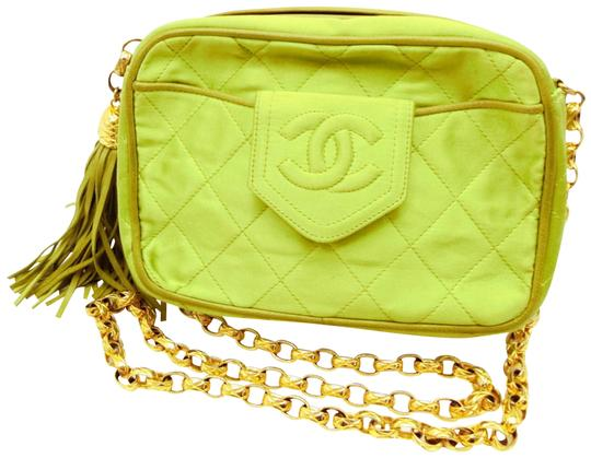Preload https://img-static.tradesy.com/item/24978498/chanel-case-camera-fringe-tassel-quilted-234644-green-satin-cross-body-bag-0-1-540-540.jpg