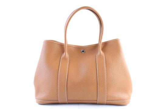 Preload https://img-static.tradesy.com/item/24978645/hermes-garden-party-ebay-sold-gold-36-negonda-1hr0313-brown-leather-tote-0-0-540-540.jpg