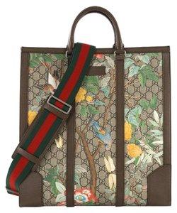 64c60dc1ae3 Gucci Canvas Tote in brown. Gucci Web Strap Convertible Tian Print Gg Tall  Brown Coated ...