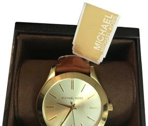 565238dc84f2 Beige Michael Kors Watches - Up to 70% off at Tradesy