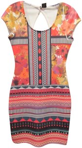 Fire short dress Multi-Color Orange Scoop Neck Keyhole On Back Lithe Sleeve Floral/Tribal Print Vibrant Colors on Tradesy