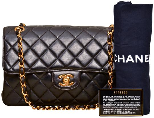 Preload https://img-static.tradesy.com/item/25001092/chanel-10-inch-quilted-double-sided-single-flap-with-gold-chains-black-lambskin-leather-shoulder-bag-0-1-540-540.jpg