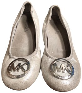 5603f0129ffc Silver Michael Kors Flats - Up to 90% off at Tradesy