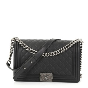 57013a10bd8c23 Added to Shopping Bag. Chanel Leather Cross Body Bag. Chanel Classic Flap  Boy Quilted New Medium Black Calfskin ...