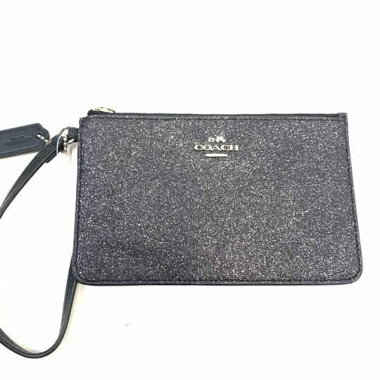 Preload https://img-static.tradesy.com/item/25011855/coach-black-small-wristlet-with-glitter-star-wallet-0-0-540-540.jpg