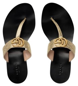53a0b36bc31 Gucci Loafer Mule Slide Flat Marmont gold Sandals - item med img. Gucci.  Gold Marmont Platino Gg Logo Black Mule Thong Flat Flip Flop Sandals