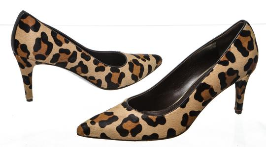 Preload https://img-static.tradesy.com/item/25018747/stuart-weitzman-black-tan-brown-calf-hair-leopard-pumps-size-us-9-regular-m-b-0-0-540-540.jpg