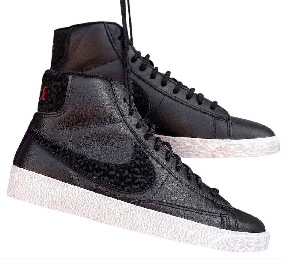 fce496c6537b3 Nike Black Women's Mid Rebel Updates The Iconic Basketball with Premium  Leather and Textile. Sneakers