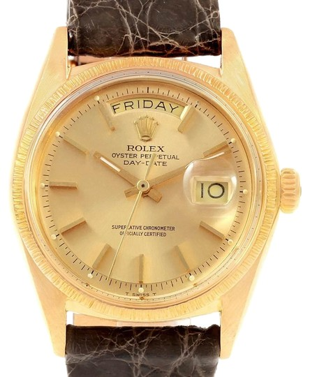 Preload https://img-static.tradesy.com/item/25028694/rolex-champagne-president-day-date-yellow-gold-brown-strap-mens-1807-watch-0-1-540-540.jpg
