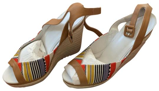 Preload https://img-static.tradesy.com/item/25029807/hermes-white-tan-red-blue-yellow-and-black-espadrilles-platform-with-tribal-print-wedges-size-eu-40-0-1-540-540.jpg