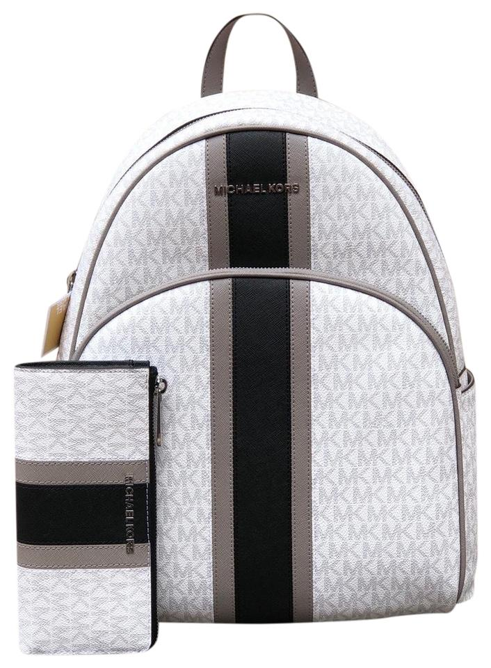 eeb3bec5b389 Michael Kors Large Abbey Center Bundled W/Wallet White/Black Stripe Pvc/Leather  Backpack