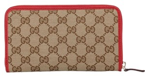 Gucci Gucci Monogram canvas tan zip around wallet GG logo