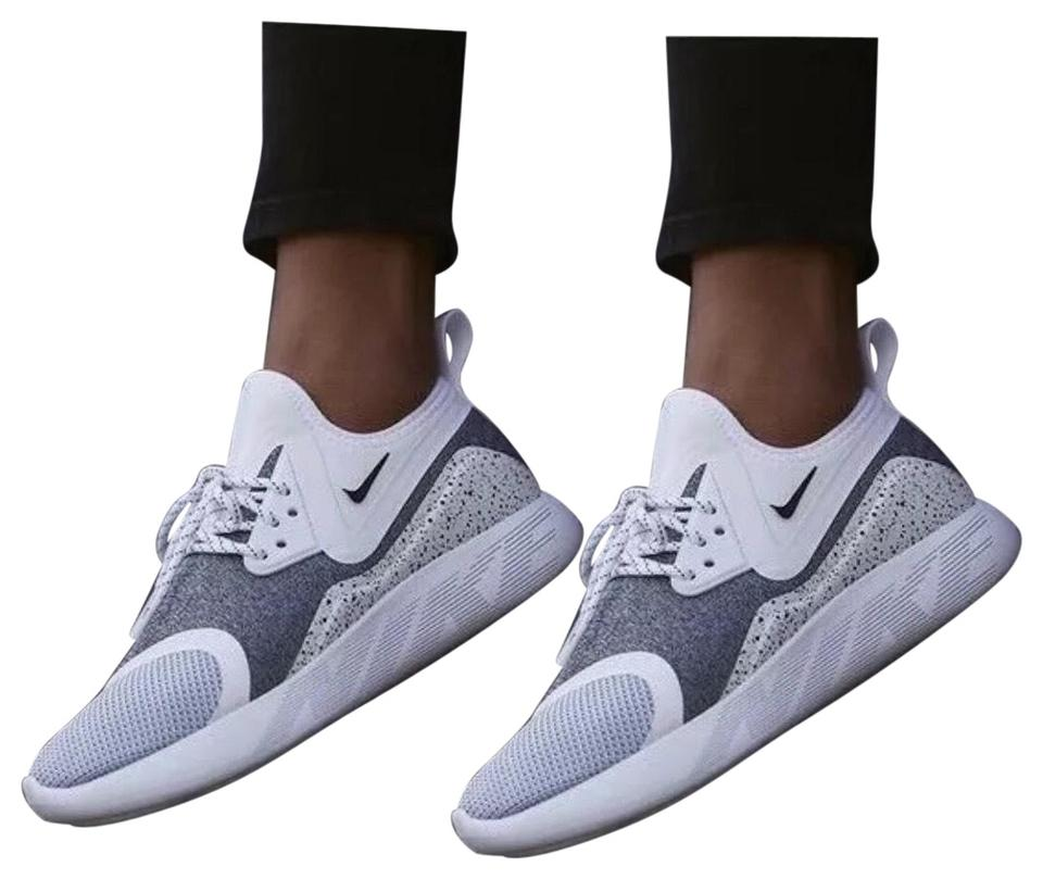 d1496e2dd0 Nike White Women's Lunarcharge Essential Sneakers Features A Comfortable  Neoprene Boot Construction. Style/Color: 923620-100 Sneakers