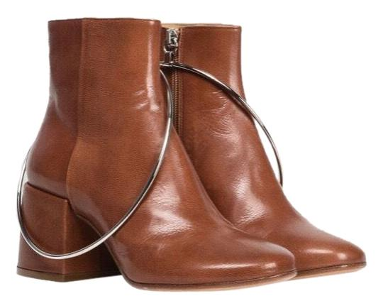Preload https://img-static.tradesy.com/item/25040236/maison-margiela-brown-mm6-ring-leather-bootsbooties-size-us-75-regular-m-b-0-1-540-540.jpg