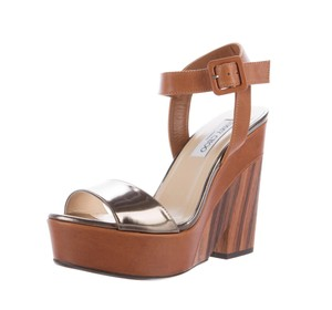 080536afe908 Women s Gold Jimmy Choo Shoes - Up to 90% off at Tradesy