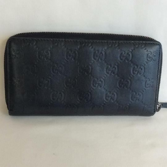Gucci Leather zip around Classic Monogramed Gg