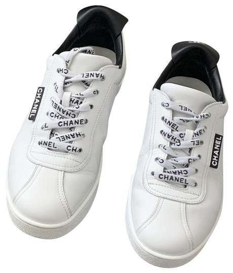 Preload https://img-static.tradesy.com/item/25042259/chanel-white-and-black-calfskin-sneakers-size-us-7-regular-m-b-0-2-540-540.jpg
