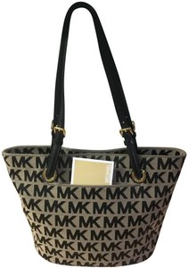 ef45a83484c7a Michael Kors Outside Pocket Leather Straps Adjustable Straps Inside Zipper  Tote in Tan and Black