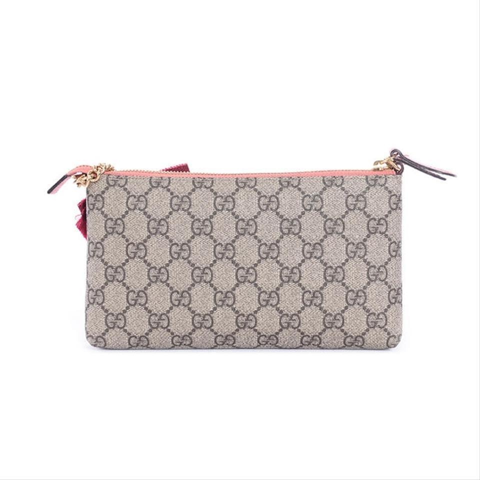 0cab16fb3 Gucci Gg Supreme Embroidered Face Chain Wallet Wristlet in Brown Image 11.  123456789101112