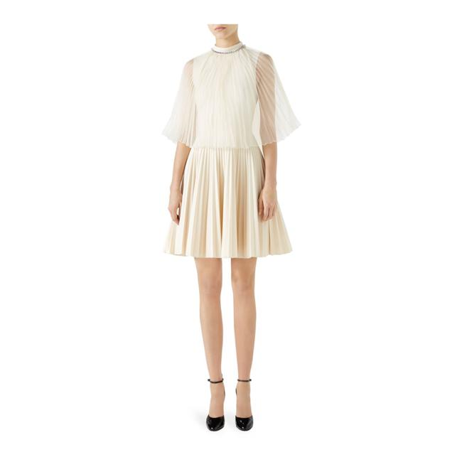 Preload https://img-static.tradesy.com/item/25075788/gucci-creamoff-white-jersey-pleated-organza-short-casual-dress-size-12-l-0-0-650-650.jpg