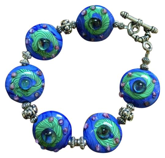 Preload https://img-static.tradesy.com/item/250864/silpada-blue-green-tortoise-beaded-bracelet-0-0-540-540.jpg