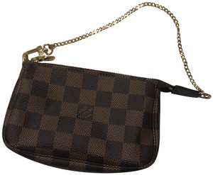 3c7c3178ca5d Louis Vuitton Leather Damier Canvas Coated Gold Hardware Wristlet in Brown