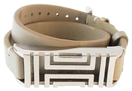 Preload https://img-static.tradesy.com/item/25099070/tory-burch-taupe-light-surface-scratches-on-hardware-tech-accessory-0-1-540-540.jpg