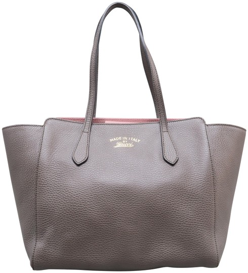Preload https://img-static.tradesy.com/item/25101547/gucci-swing-small-taupe-calfskin-leather-tote-0-1-540-540.jpg