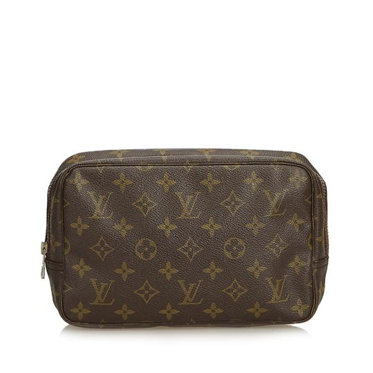 Preload https://img-static.tradesy.com/item/25101744/louis-vuitton-trousse-monogram-toilette-23-france-brown-coated-canvas-leather-wristlet-0-0-540-540.jpg