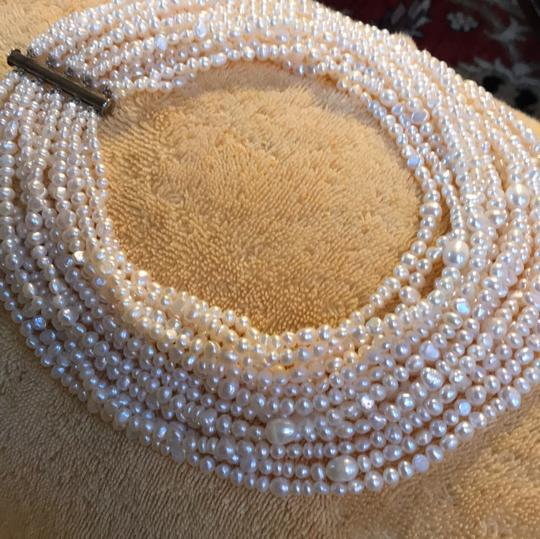 Preload https://img-static.tradesy.com/item/25111244/saks-fifth-avenue-creamy-pearls-and-silver-bar-closure-freshwater-multi-strand-from-necklace-0-2-540-540.jpg