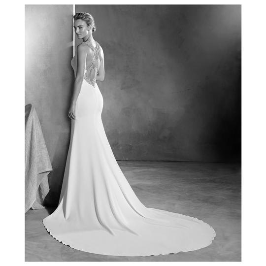 Preload https://img-static.tradesy.com/item/25112940/pronovias-crepe-emmett-embellished-open-back-gown-modern-wedding-dress-size-10-m-0-0-540-540.jpg