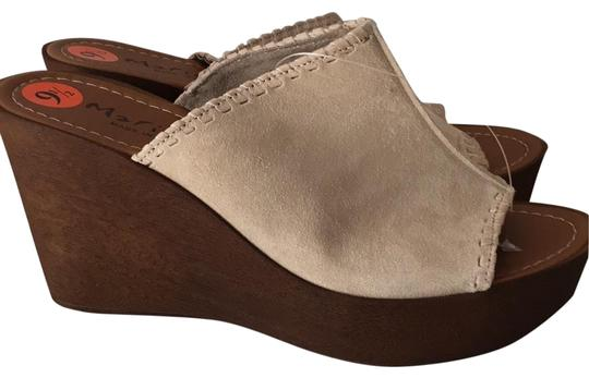 Preload https://img-static.tradesy.com/item/25119922/beige-suede-leather-wedge-whipstitch-wedge-sandals-size-us-95-regular-m-b-0-2-540-540.jpg